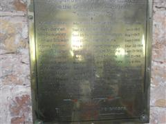 Showing the brass plaque situated below the window containing 27 names of the fallen.