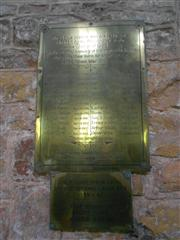 Showing the brass plaque below the memorial window.