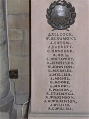 Photo showing a close up of the names of the fallen on the stone lectern memorial in St Winifred's Church. 
