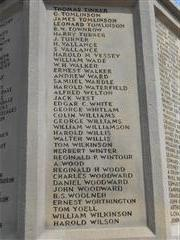 Photos shows the panel containing the names of the fallen T - W