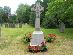 Photo shows the recently cleaned memorial cross in the churchyard of St Mary's Church at Bleasby, It is the intention to have the lettering re leaded and two additional names added. 