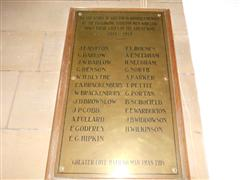 Brass plaque on an oak backboard with the names of 23 men who were killed in the Great War.