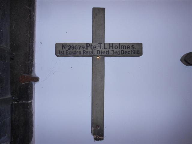 Photo shows the battlefield cross marking the grave of Thomas Lister Holmes which is now on display within St Peters Church at Sturton Le Steeple.