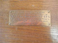 Photo shows close up of the inscription on the litany table on display inside St Peters Church, Sturton Le Steeple commemorating Fred Eric Warburton.