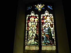 Stained glass window in St Peter's Church Farmdon commemorating 