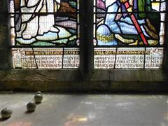 Inscription stained glass window commemorating Charles Edgar Harrison. 