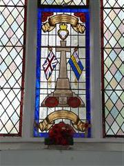 Stained glass window in St Giles Church, Ollerton, depicting the memorial cross in the village. Photograph Rachel Farrand (March 2013)