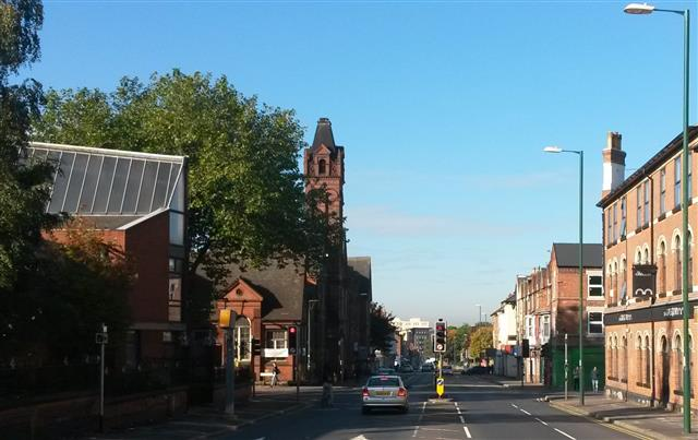 The junction of Ilkeston Road with Radford and Lenton Boulevards which is the heart of All Souls Parish Radford. Tradition has it that locals used to refer to this spot as 'Ation Corner' because the intersection was overlooked by a church (Salvation), a school (Education), a public house (Damnation) and a pawnbroker's shop [long since closed but formerly behind the green shuttering] (Temptation).