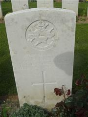Commonwealth war grave headstone marking the grave at Guillemont Road Cemetery, Guillemont, Somme, France . Courtesy of Murray Biddle