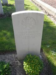 Commonwealth war grave headstone marking his grave at Fouquieres Churchyard extension, Pas de Calais. 