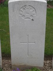 Commonwealth War Graves Commission headstone marking his grave at Grove Town Cemetery, Meaulte, Somme France. Courtesy of Murray Biddle