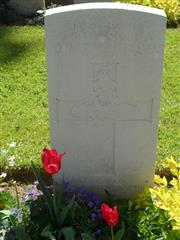 Commonwealth war grave headstone marking his grave at Tourgeville Military Cemetery, Calvados, France . Courtesy of Murray Biddle