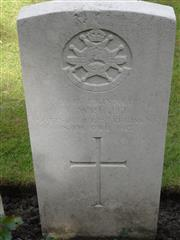 Commonwealth war grave headstone marking his grave at Kemmel Chateau Military Cemetery, France . Courtesy of Murray Biddle