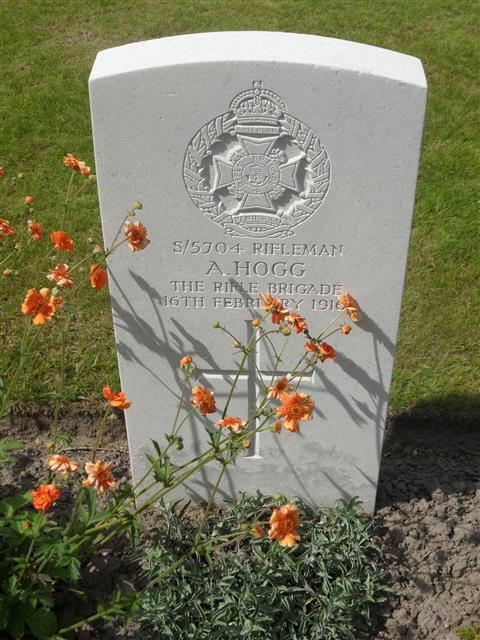 Commonwealth War Graves Commission headstone marking his grave at Essex Farm Cemetery,  Belgium.