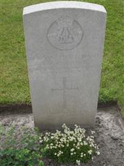 Commonwealth war grave headstone marking his grave at Bard Cottage  Cemetery,  Belgium.