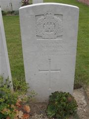 Commonwealth war grave headstone marking his grave at Lowrie Cemetery, Havrincourt . Courtesy of Murray Biddle