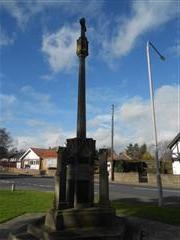 This memorial cross stands outside St Anne's Church on Newcastle Ave, Worksop