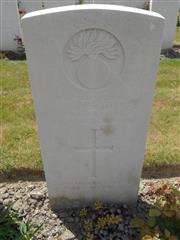 Commonwealth War Grave Commission headstone marking his grave at Dozingham Military Cemetery. Courtesy of Murray Biddle