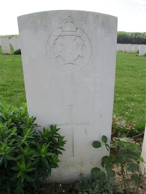 Buried in Guillemont Road Cemetery.