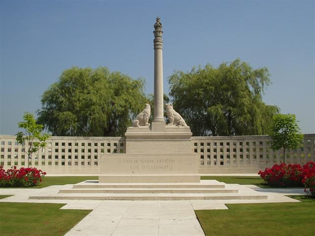 'The Indian Memorial at Neuve Chapelle commemorates over 4,700 Indian soldiers and labourers who lost their lives on the Western Front during the First World War and have no known graves. The location of the memorial was specially chosen as it was at Neuve Chapelle in March 1915 that the Indian Corps fought its first major action as a single unit. The memorial takes the form of a sanctuary enclosed within a circular wall after the manner of the enclosing railings of early Indian shrines. The column in the foreground of the enclosure stands almost 15 feet high and was inspired by the famous inscribed columns erected by the Emperor Ashkora throughout India in the 3rd century BC. The column is surmounted with a Lotus capital, the Imperial British Crown and the Star of India. Two tigers are carved on either side of the column guarding the temple of the dead. On the lower part of the column the words 'God is One, He is the Victory' are inscribed in English, with similar texts in Arabic, Hindi, and Gurmukhi. 
