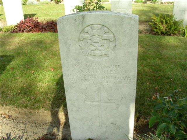 The commonwealth wargraves commission headstone marking the grave of Anthony John Harley at Dranoutre Military Cemetery, Belgium and courtesy of Pearlady and findagrave website