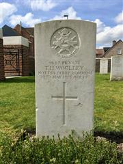 The commonwealth wargraves commission headstone marking the grave of Thomas Henry Woolley at Le Touquet Railway Crossing Cemetery is courtesy of David Alton