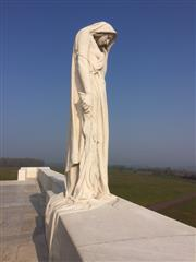 Overlooking the Douai Plain, a cloaked, sorrowing woman stands at the front of Walter Seymour Allward's magnificent Vimy Ridge Memorial to Canada's Great War dead and missing. She represents Canada - a young nation mourning her dead.