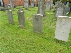 The four commonwealth wargraves commission headstones marking the graves of John Henry Sharp and his friends at St Magdelene Churchyard, Creswell, Derbyshire courtesy of Peter Gillings