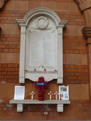 Armistice Day, 11 November 2018. Poppy Cross with personal tributes to JH Brockwell (1/7/1916), GW Dignen (23/10/1918), T Henshaw (25/9/1915) and C Smith (12/3/1915). Photograph Rachel Farrand.