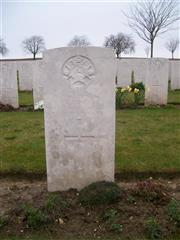 The CWGC headstone of Edward Fines in Ovilliers Military Cemetery