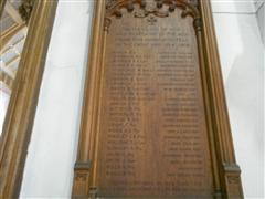 Photo shows the wooden memorial board inside St Michael's Church showing the names of the 24 fallen parishioners below the inscription which reads ' To The glory of God and in memory of the men from this parish who fell in The Great War 1914-1918 .