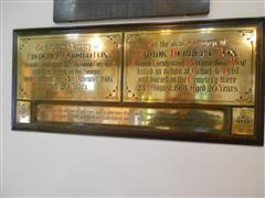 Brass memorial plaque commemorating Frank Herbert Fox and his brother Frederick Donald Fox in St John the Baptist Church, Beeston. (WMA 27233)