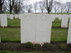 The Commonwealth War Graves Commission headstone marking the grave of William Foster at Essex farm Cemetery , visited by , wreath laid and photo courtesy of John Morse