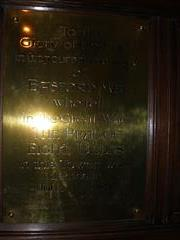 Brass plaque commemorating the donation of the peal of bells in memory of those who had died in the war. Photograph Rachel Farrand (May 2011)