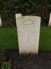 Commonwealth War Graves Commission headstone marking the grave of Barry Maynard Denny in Ypres Town cemetery, Belgium. 