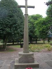 Photo shows the cross dedicated to the parishioners of St Peters within the churchyard. 