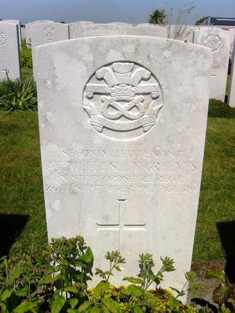 The Commonwealth War Graves Commission headstone, marking the grave of Arthur Frederick Wellesley Greeves in La Clytte Military cemetery, Belgium, grave reference III A 9