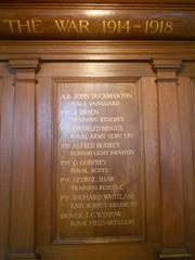 This shows a closer view of the wooden organ screen within the church upon which the names of the fallen have been placed .Photo by Peter Gillings