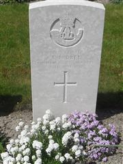 Commonwealth War Graves Commission headstone marking his grave at Philosophe British Cemetery, Mazingarbe, France.