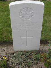 Commonwealth War Graves Commission headstone marking his grave at Tyne Cot Cemetery, Belgium,