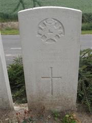 Commonwealth war grave headstone marking his grave at Ribecourt Road Cemetery, Trescault. 