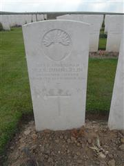 Commonwealth War Graves Commission headstone marking his grave at Guards Cemetery, Lesboeufs. 