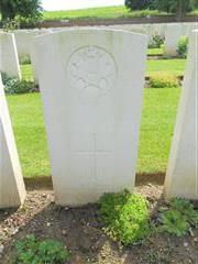 Commonwealth War Graves  Commission headstone marking the grave of Percy Pollard at Ancre British Cemetery . 