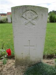 Buried in Bouzincourt Communal Cemetery Extension.